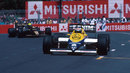 Keke Rosberg leads Ayrton Senna through the streets
