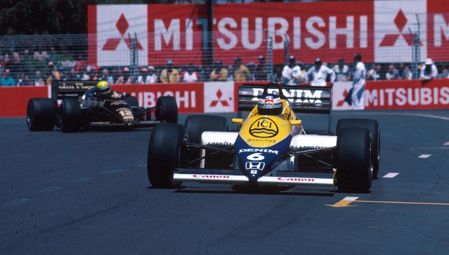 Keke Rosberg leads Ayrton Senna through the streets