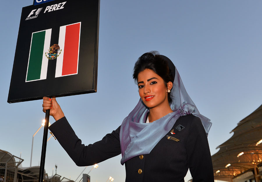 A grid girl poses at Sergio Perez's spot on the grid