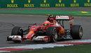 Kimi Raikkonen exits a corner