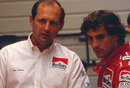 Ron Dennis and Ayrton Senna talk in the paddock, circa 1990