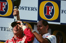Ron Dennis sprays Ayrton Senna with champagne