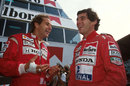 Gerhard Berger shares a joke with team-mate Ayrton Senna