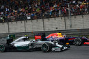 Nico Rosberg passes Sebastian Vettel into the hairpin