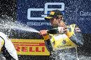 Felipe Nasr sprays champagne on the podium