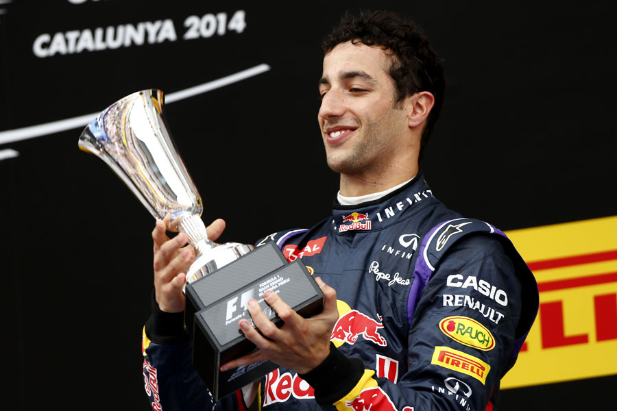 Daniel Ricciardo admires the trophy after securing his maiden podium