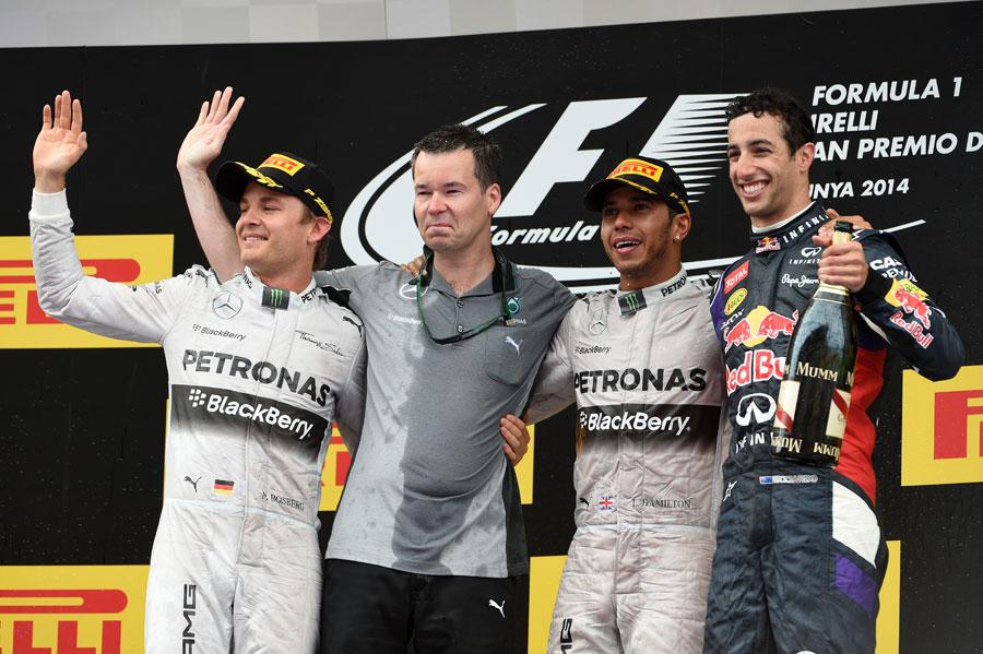 Nico Rosberg, Mercedes' Mike Elliot, Lewis Hamilton and Daniel Ricciardo pose on the podium