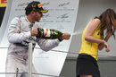 What would Nicole say? Lewis Hamilton celebrates victory by soaking a grid girl