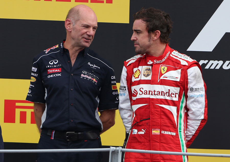 Adrian Newey talks to Fernando Alonso on the podium