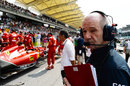 Adrian Newey takes a look at the Ferrari on the grid
