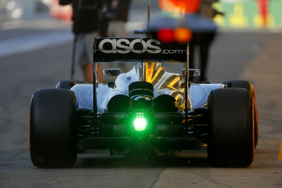 Stoffel Vandoorne in the McLaren with a green rookie rain light