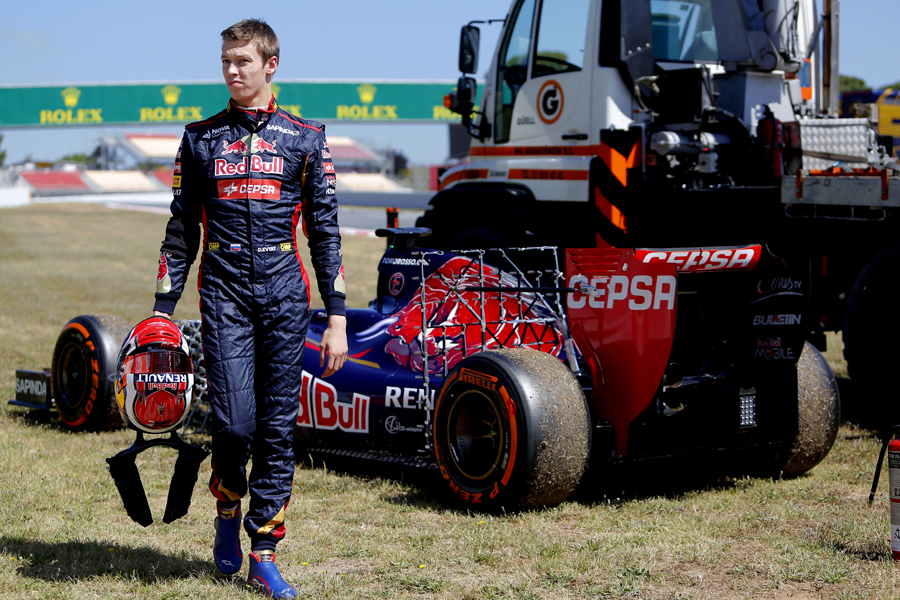Daniil Kvyat walks away from his stricken Toro Rosso