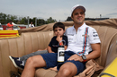 Felipe Massa takes his son with him on the drivers' parade