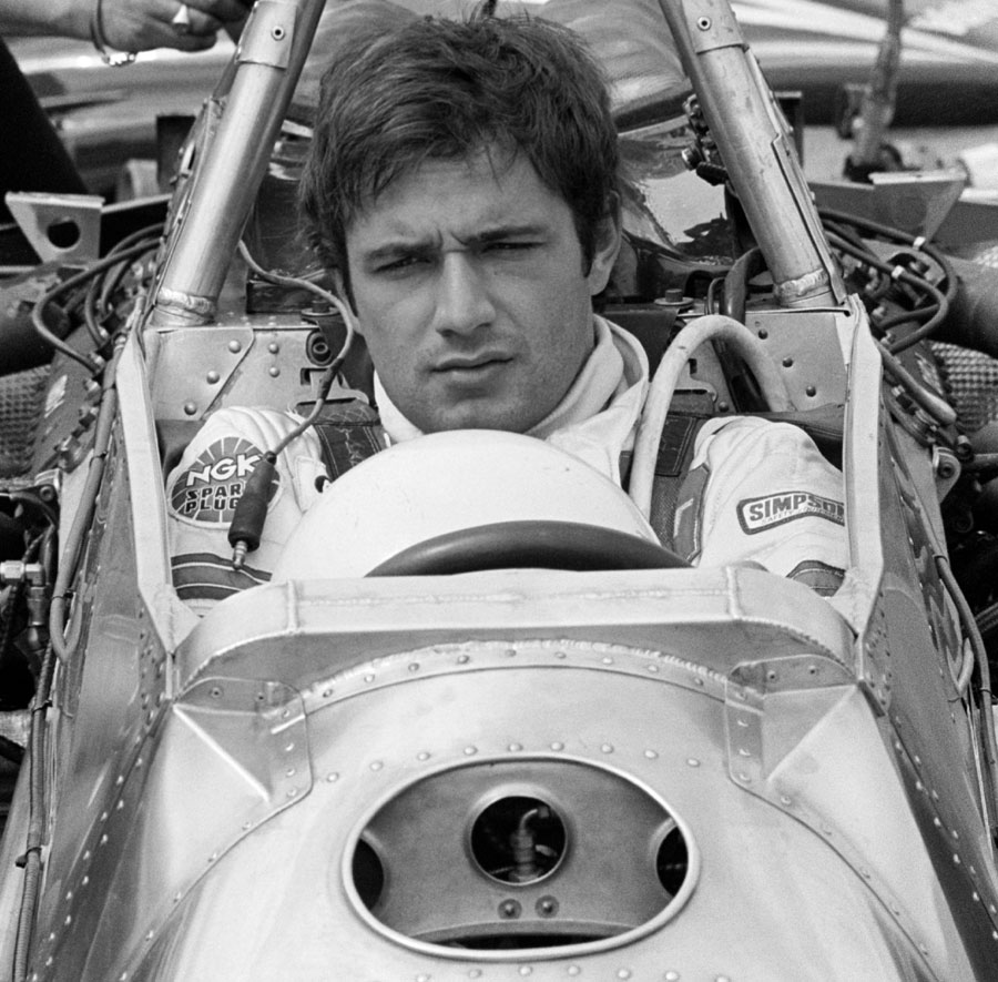 Elio de Angelis sits in the cockpit ahead of the race