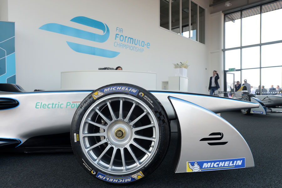 A Formula E car sits in the lobby of the series' headquarters at Donnington Park