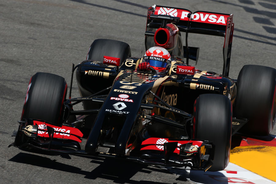 Romain Grosjean bounces over a kerb on the supersofts