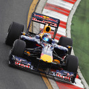 Mark Webber rides the kerb on his way to the fastest lap