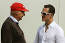 Michael Schumacher chats with Niki Lauda