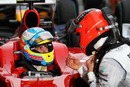 Michael Schumacher shares his thoughts with Fernando Alonso