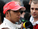 Lewis Hamilton talks to the press after a disappointing qualifying