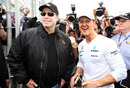 Michael Schumacher is visited by John Travolta