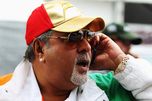 Force India's ever-so-trendy  chairman Vijay Mallya walks in the paddock