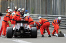 Marshals get to work on removing Esteban Gutierrez's beached car and debris at Rascasse