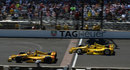 Ryan Hunter-Reay raises his arm aloft in celebration after edging Helio Castroneves across the line in the Indy 500