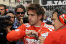Fernando Alonso stands on the grid before the race
