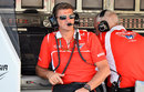 Marussia's Graeme Lowdon looks on from the pit wall