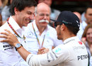 Lewis Hamilton celebrates with Mercedes boss Toto Wolff