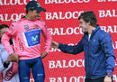 Fernando Alonso hands Colombian Nairo Quintana the leader's maglia rosa after the 18th stage of the Giro d'Italia