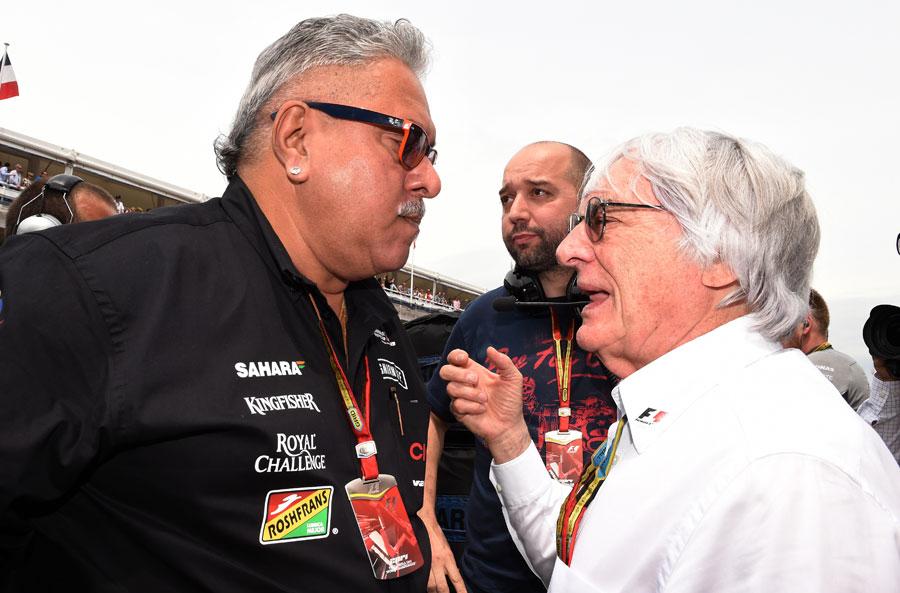 Vijay Mallya talks to Bernie Ecclestone on the grid prior to the race