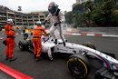 Valtteri Bottas climbs from his stricken Williams at the Loews Hairpin after an engine failure