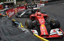 Kevin Magnussen and Kimi Raikkonen come to a stop making contact at Loews
