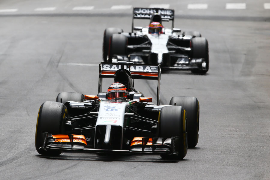Nico Hulkenberg approaches Ste Devote with Jenson Button in his mirrors