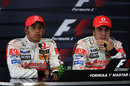 Lewis Hamilton and Fernando Alonso look on after a controversial qualifying session