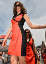 A grid girl arrives on track before the start of the race