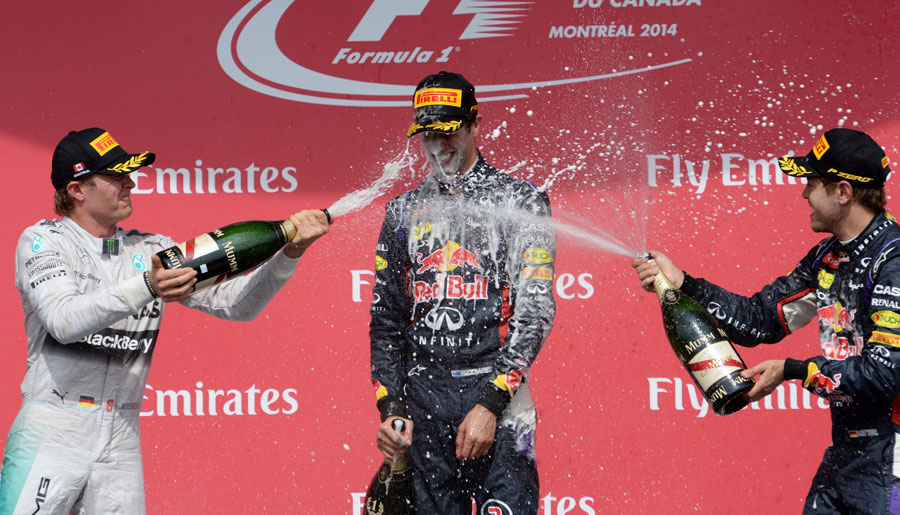 Nico Rosberg and Sebastian Vettel soak Daniel Ricciardo after his maiden victory