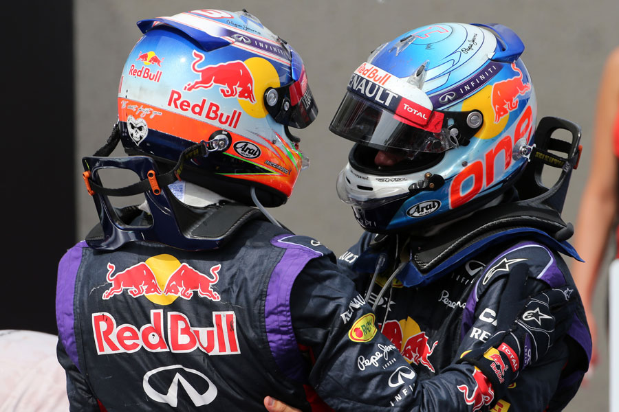 Sebastian Vettel (right) congratulates Daniel Ricciardo in parc ferme after his maiden victory