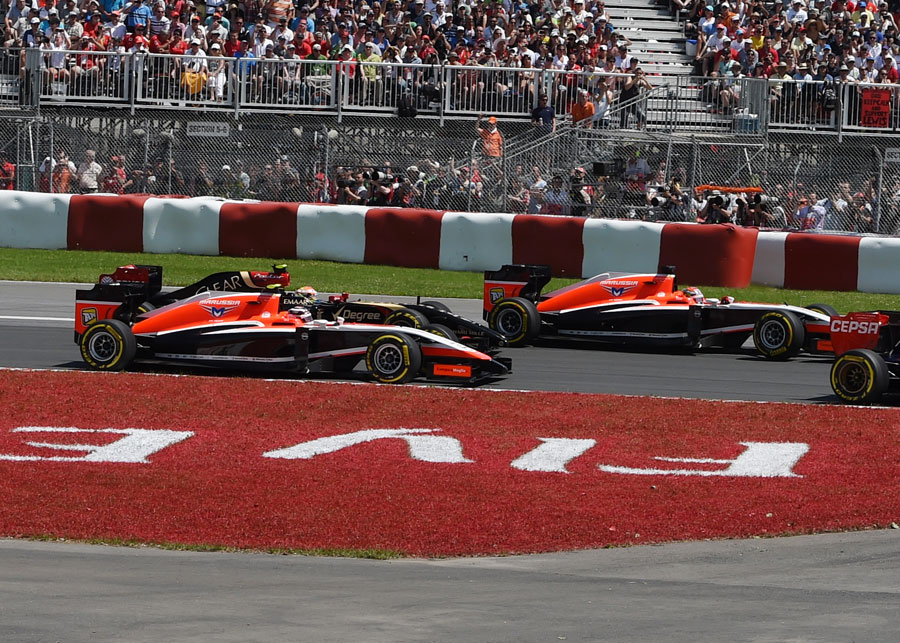 The Marussias of Max Chilton and Jules Bianchi head towards Turn 4, where they would collide and be forced to retire from the race