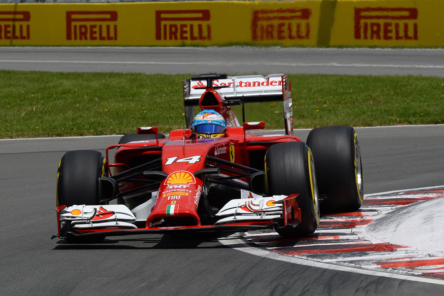 Fernando Alonso rounds the kerb