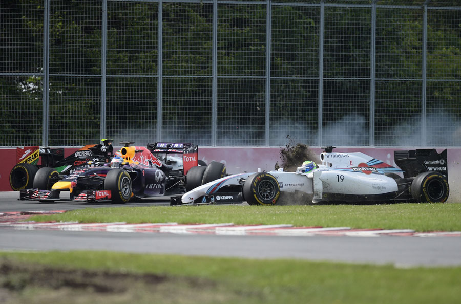 Sebastian Vettel narrowly avoids being collected by Felipe Massa after his collision with Sergio Perez