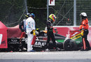 Sergio Perez walks away from his wrecked Force India