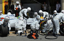 The Williams pit crew struggle to fit Felipe Massa's front left tyre
