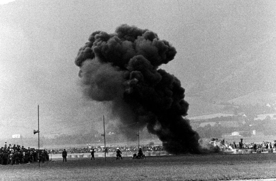 Phil Hill's empty Cooper burns after a crash