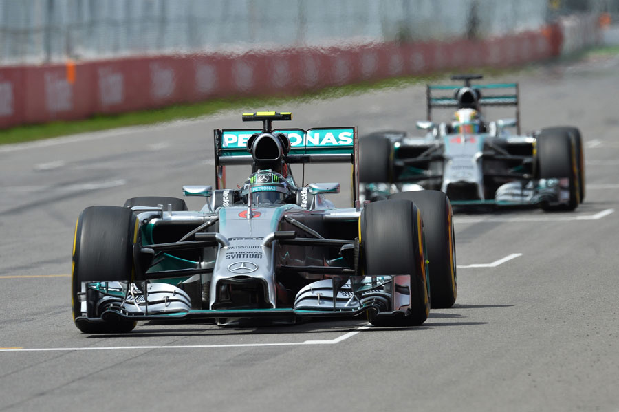 Nico Rosberg starts another lap with Lewis Hamilton in hot pursuit