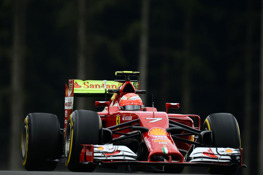 Kimi Raikkonen on track with a car covered in aero paint