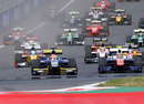 Felipe Nasr leads on the run up to Turn 1 from pole-sitter Johnny Cecotto