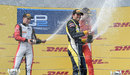Felipe Nasr sprays champagne to celebrate victory, flanked by Stoffel Vandoorne and Raffaele Marciello